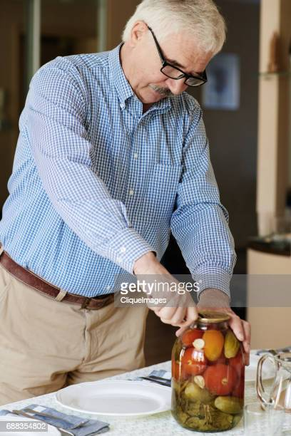 head of family opening pickle jar - cliqueimages stock pictures, royalty-free photos & images
