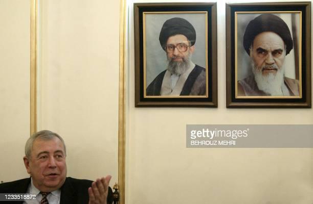 Head of Federal Atomic Energy Agency of Russia, Alexander Rumyantsev speaks with journalists under portraits of Iran's supreme leader Ayatollah Ali...