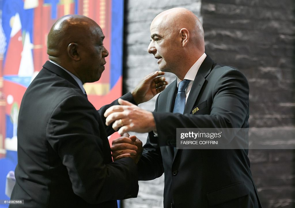 Head of FIFA's monitoring mission on the Israel-Palestinian issue of football, South Africa's Tokyo Sexwale (L)hugs FIFA President Gianni Infantino after a meeting of the FIFA Council on October 14, 2016 at the world football's governing body headquarters in Zurich. The Palestine Football Association has written to Infantino calling on FIFA to demand the Israeli Football Association expel the clubs based on Jewish settlements in the occupied West Bank, which are considered illegal under international law. / AFP / FABRICE