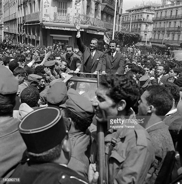 Head of FLN Ahmed Ben Bella and Egyptian president Gamal Abdel Nasser waving to crowd during the visit of the Egyptian president in Algeria on May 5...