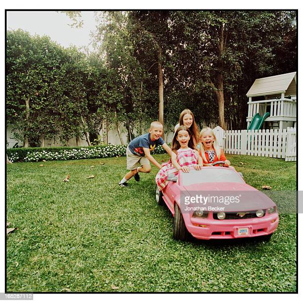 Head of Ford Global Brand Entertainment Alessandro Uzielli's daughters Olivia and Eleanor are photographed with Madeleine and George Nicks for Town...