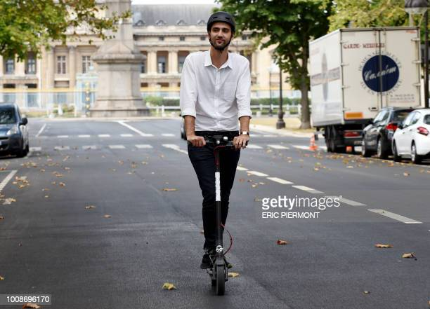 Head of France of US electric scootersharing service Bird Kenneth Schlenker drives on one of the company's electric scooters in Paris on July 31 2018...