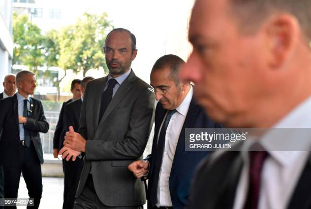 Head of France's intelligence agency DGSI Laurent Nunez and French Prime Minister Edouard Philippe arrive at the DGSI in LevalloisPerret west of...