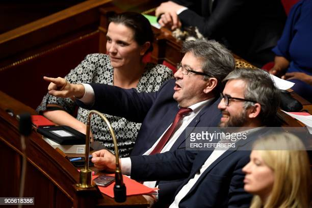 Head of French leftist party La France insoumise JeanLuc Melenchon and member of Parliament Alexis Corbiere react during a session of questions to...