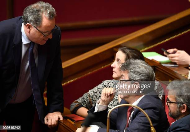 Head of French leftist party La France insoumise JeanLuc Melenchon speaks with La Republique en Marche member of Parliament Richard Ferrand during a...