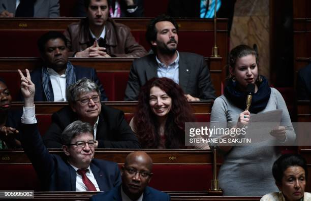 Head of French leftist party La France Insoumise JeanLuc Melenchon gestures as LFI MP Mathilde Panot asks a question during a session of questions to...