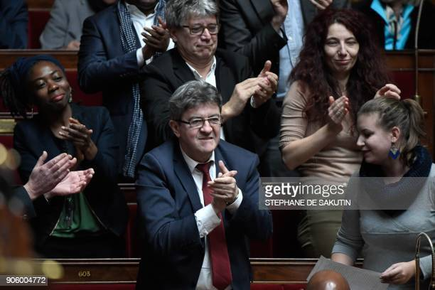 Head of French leftist party La France Insoumise JeanLuc Melenchon applauds after LFI MP Mathilde Panot asked a question during a session of...