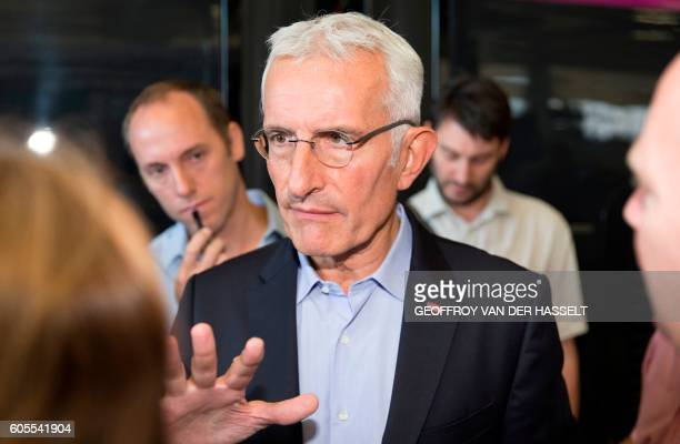 Head of French national stateowned railway company SNCF Guillaume Pepy gestures as he speaks with journalists during the presentation of the new TGV...