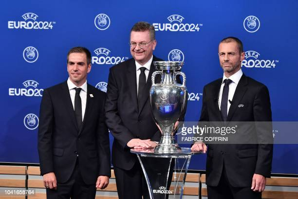 Head of Germany's bid to host the Euro 2024 Philipp Lahm German Football Association president Reinhard Grindel and UEFA president Aleksander Ceferin...