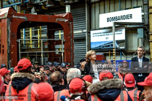 Head of IledeFrance regional council Valerie Pecresse speaks to workers during a visit to the Bombardier plant in Crespin near Valenciennes on...