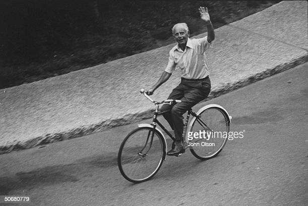 Head of Institute of Exprimmental Research and Surgery Dr Hans Selye riding on a bicycle