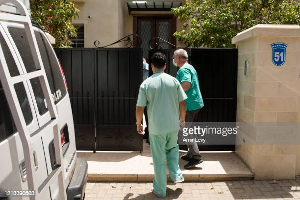 Head of Israel National Center of Forensic Medicine Dr Chen Kugel and a colleague enter the house of China's Ambassador to Israel Du Wei, after he...