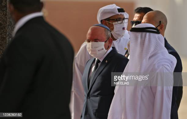 Head of Israel's National Security Council Meir Ben-Shabbat is welcomed upon his arrival, as part of an Israeli-American delegation, at the Abu Dhabi...