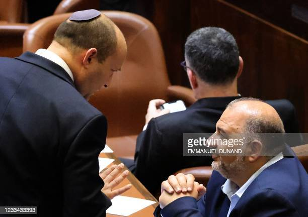 Head of Israel's right-wing Yamina party Naftali Bennett chats with Mansour Abbas, head of the conservative Islamic Raam party during a special...