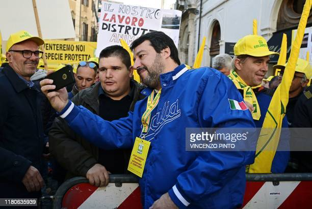 Head of Italy's far-right League party, Matteo Salvini poses for selfie photos with farmers during a demonstration of farmers, some members of the...