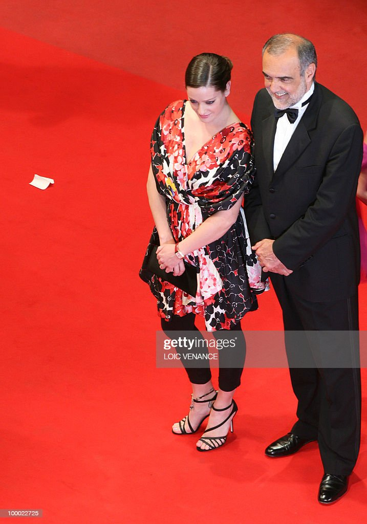 Head of Italy's national film museum Alberto Barbera and Italian actress Giovanna Mezzogiorno arrive for the screening of 'La Nostra Vita' (Our Life) presented in competition at the 63rd Cannes Film Festival on May 20, 2010 in Cannes.