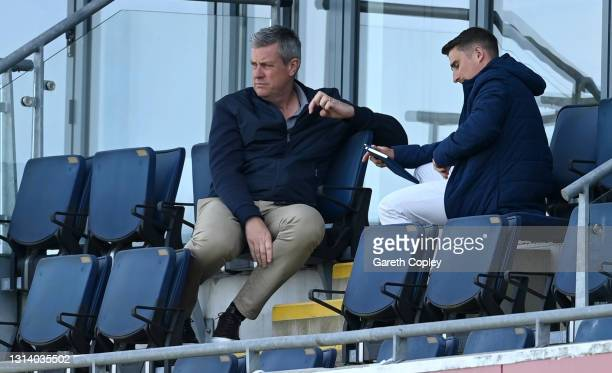 Head of Mens Cricket Ashley Giles and Chief Scout James Taylor watch play during the LV= Insurance County Championship match between Warwickshire and...