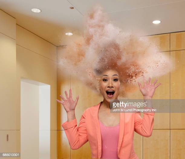 Head of Mixed Race businesswoman exploding