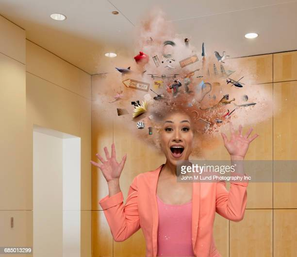 Head of Mixed Race businesswoman exploding with ideas
