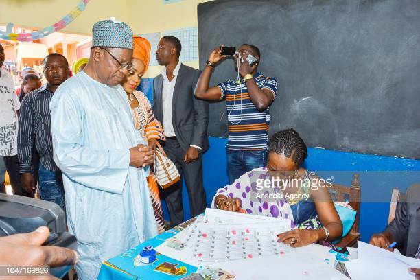 Head of Movement for the Rebirth of Cameroon and presidential candidate Maurice Kamto arrives to cast his vote at a polling station during...