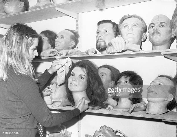 A 'head' of Mrs Jacqueline Kennedy Onassis is dusted in a storeroom that is a kind of 'death row' at Madame Tussaud's Waxworks in London 'Heads' of...