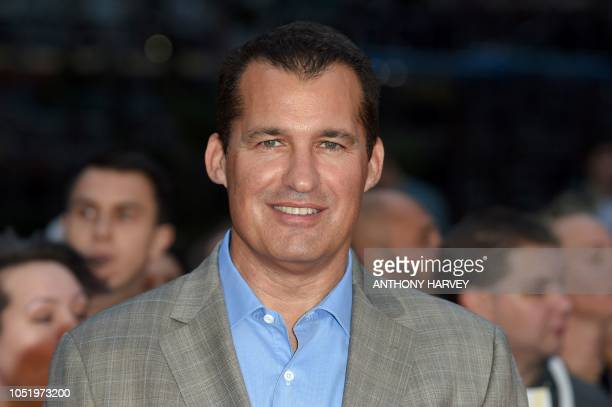 Head of Original Films at Netflix Scott Stuber poses upon arrival for the UK premiere of the film 'The Ballad of Buster Scruggs' during the BFI...