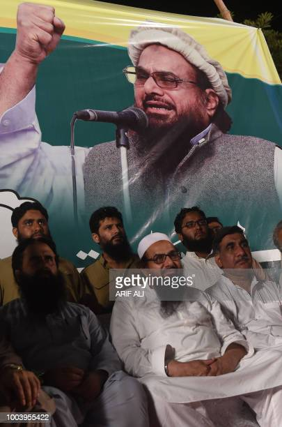 Head of Pakistani banned organisation JamaatudDawa Hafiz Saaed attends the election campaign meeting in Lahore on July 22 ahead of the general...