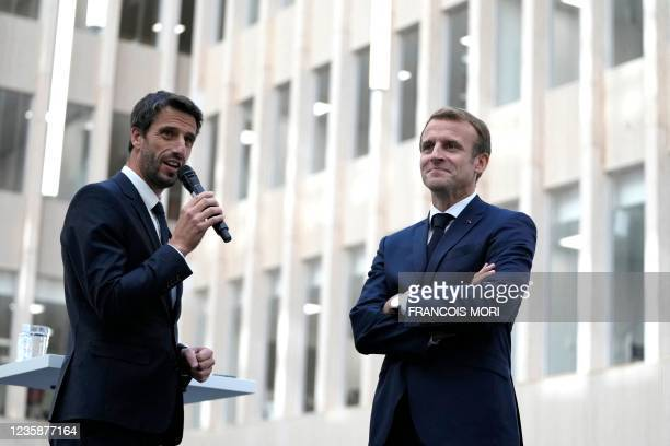 Head of Paris 2024 Tony Estanguet and French President Emmanuel Macron talk to staff members at the headquarters of the Paris 2024 Organising...