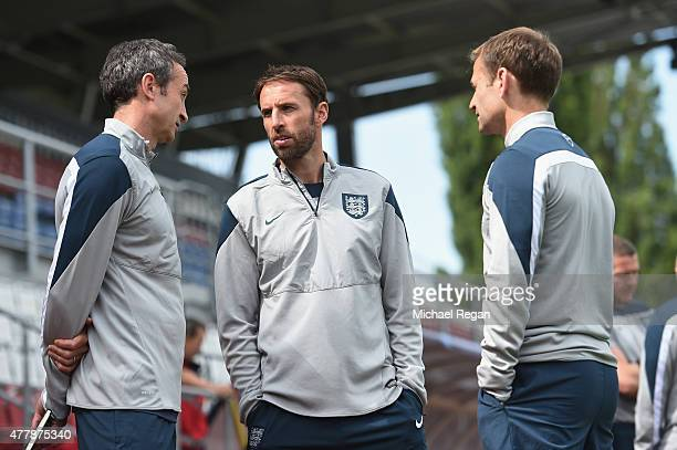 Head Of Performance Services Dave Reddin speaks to England U21 manager Gareth Southgate and FA Director of Elite Development Dan Ashworth during the...