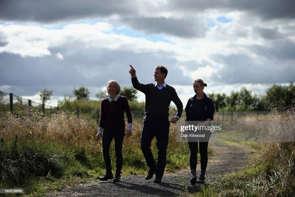 Head of Policy at Scottish Wildlife Trust Dr Maggie Keegan (L) and Cathkin Marsh Project Officer Laura Cunningham (R) show Deputy British Prime Minister and leader of the Liberal Democrats Nick Clegg around Scottish Wildlife trusts' Cathkin Marsh Nature Reserve on the first day of the Liberal Democrats Autumn conference on September 14, 2013 in Glasgow, Scotland. The Liberal Democrat Autumn conference begins in Glasgow today where the leader Nick Clegg will address the audience during a rally this evening.