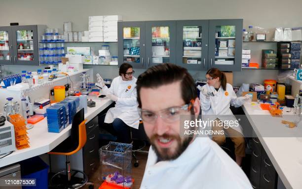 Head of quantitative pharmacology Martin Redhead and colleagues protein scientist Simon Varzandeh and laboratory technician Amelia Collette work in...