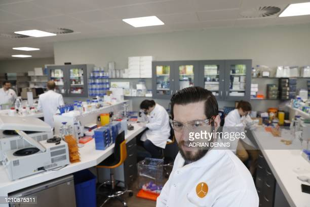 Head of quantitative pharmacology Martin Redhead and colleagues work in the laboratory of British pharmatech company Exscientia at Oxford Science...