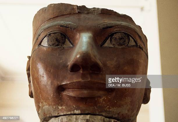Head of Queen Hatshepsut from a colossal statue in painted limestone ca 149070 bC from the Mortuary Temple of Hatshepsut Deir elBahri Luxor Thebes...
