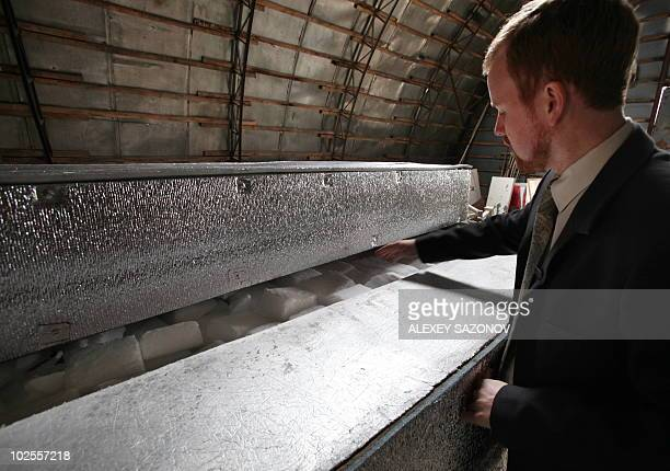 Head of Russian cryonics firm KrioRus Danila Medvedev looks inside a lowtemperature human storage unit just outside Moscow on June 17 2010 Cryonics...