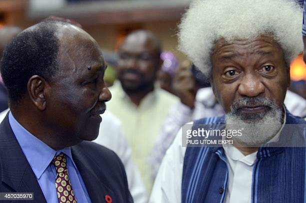 Head of State General Yakubu Gowon discusses with literary icon Professor Wole Soyinka during a lecture to celebrate Soyinka's 80th birthday in...