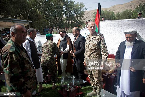 Head of the Afghanistan Peace Council and former Afghan President Burhanuddin Rabbani attends a ceremony with local officials as more than 100...