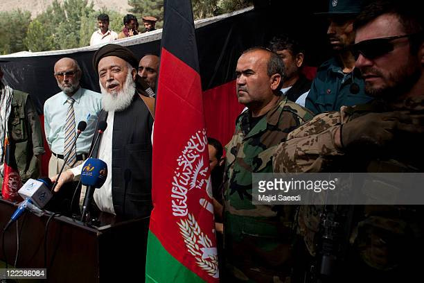 Head of the Afghanistan Peace Council and former Afghan President Burhanuddin Rabbani speaks at a ceremony with local officials as more than 100...