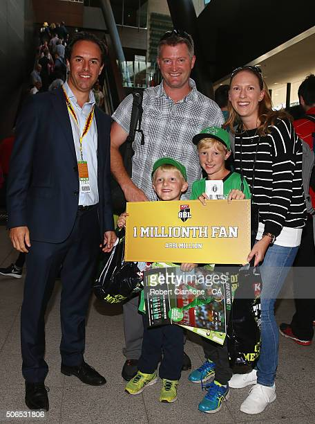 Head of the Big Bash League Anthon Everard presents the White family with a prize for being one millionth fan this season prior to the Big Bash...