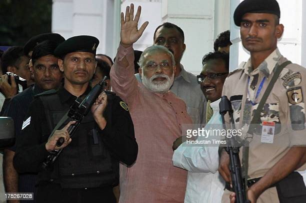 Head of the BJP poll panel and Gujarat Chief Minister Narendra Modi arrives at party headquarters for the meeting of RSS and BJP leaders on August 1...