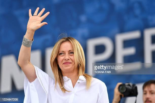 Head of the Brothers of Italy party, Giorgia Meloni waves from the stage during a united rally of the League party, the Brothers of Italy party and...