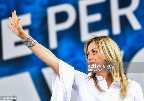 Head of the Brothers of Italy party Giorgia Meloni waves from the stage during a united rally of the League party the Brothers of Italy party and the...