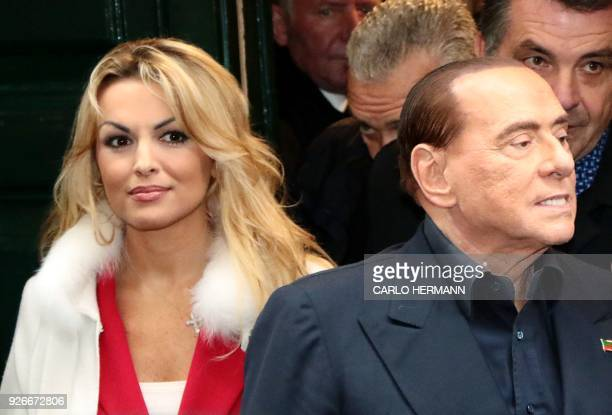 Head of the centreright Forza Italia Silvio Berlusconi leaves with his companion Francesca Pascale the San Severo chapel during his tour in downtown...
