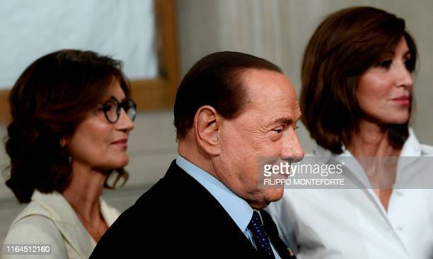TOPSHOT Head of the Chamber of Deputies Forza Italia parliamentary group Mariastella Gelmini President of the Forza Italia party Silvio Berlusconi...
