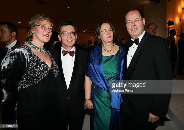Head of the Chancellery Thomas de Maiziere with his wife Martina de Maiziere and German Finance Minister Peer Steinbrueck with his wife Gertrud...