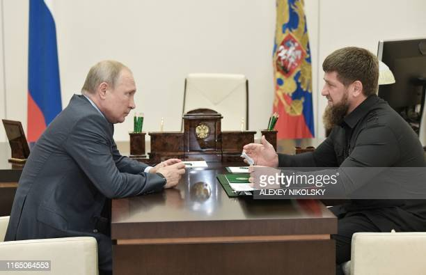 Head of the Chechen Republic Ramzan Kadyrov speaks with Russian President Vladimir Putin at the NovoOgaryovo state residence outside Moscow on August...