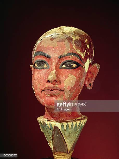 Head of the child king emerging from a lotus flower, from the Tomb of Tutankhamun (c.1370-1352 BC) New Kingdom (stuccoed & painted wood)