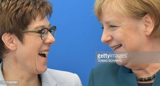 Head of the conservative German Christian Democratic Union party and German Defence Minister Annegret KrampKarrenbauer shares a smile with her party...