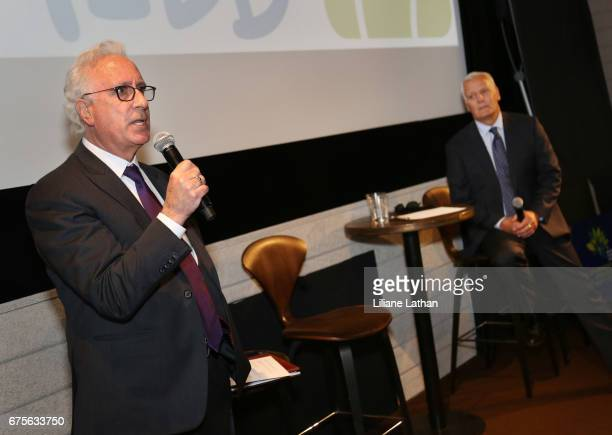 Head of the DCFS Office of Public Affairs Neil Zanville and RaiseAChild Founder and CEO Rich Valenza attend the reveal of the RaiseAChild's...