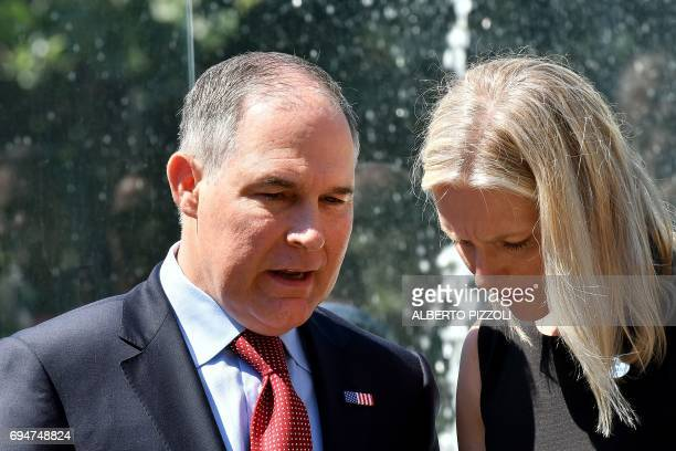 Head of the Environmental Protection Agency Scott Pruitt and Canada's Environment Minister Catherine McKenna talk prior to posing for a group photo...