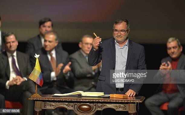 Head of the FARC guerrilla Timoleon Jimenez aka Timochenko gets ready to sign the historic peace agreement between the Colombian government and the...